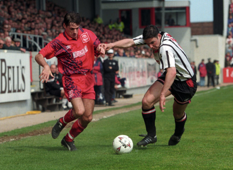 Joe Miller goes past Dunfermline's Andy Tod.