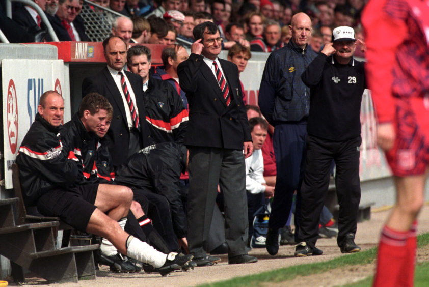 Dunfermine manager Bert Paton in the dugout.