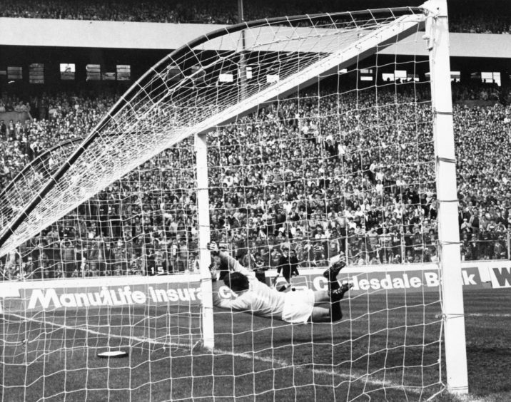 Rangers' keeper Jim Stewart dives in vain as Alex McLeish scores Aberdeen's first goal and equalises for the Dons with a high dipping shot.
