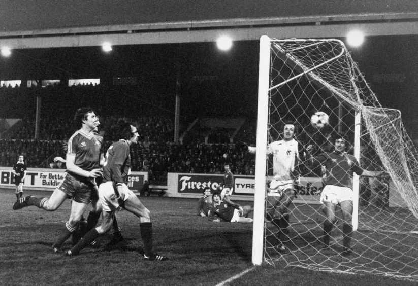 One that got away. Willie Garner watches the ball sail into the net, but the goal was disallowed because on an infringement.