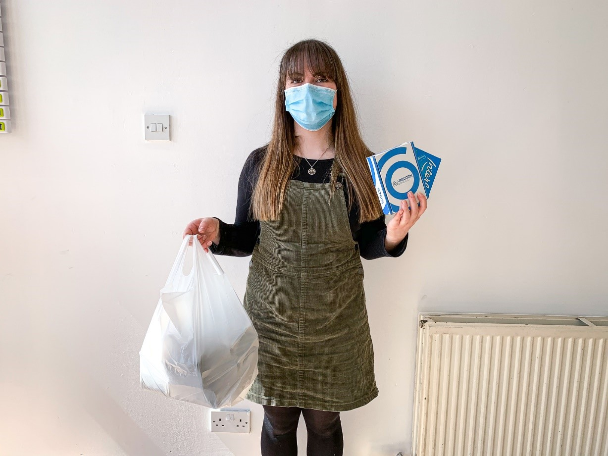 Sophie Morrison, Cfine development worker with some of the sanitary products.