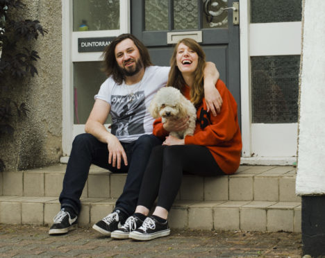 Photographer Beth Hopkins is taking pictures of Aberdeen residents on their doorsteps. Image of the Cummings family, Vicki, Keith and their dog Luna