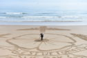 Dougie created the image at Aberdeen beach. Picture by Paul Glendall