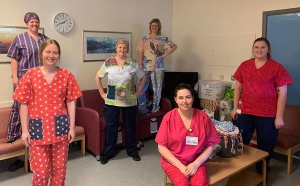 Staff from the ICU nursing team wearing the scrubs made by Finzean Scrub Hub