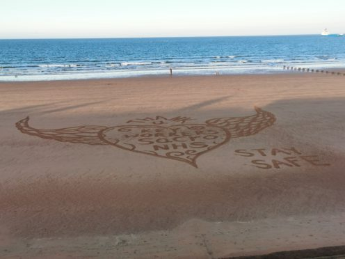 Dougie Bodie created a sand art piece for Clap for Carers on Aberdeen beach
