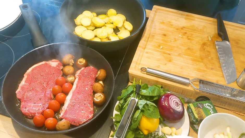Steak's and potatoes cooking