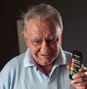 Ken Carter with his specially-adapted Synapptic phone