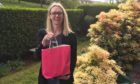 Brig O' Dee Bar manager Nicola Williams with one of the goodie bags.