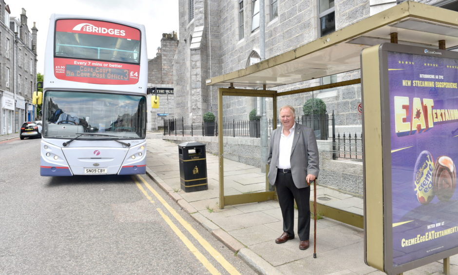Bill Cormie at the bus stop in Rosemount Place