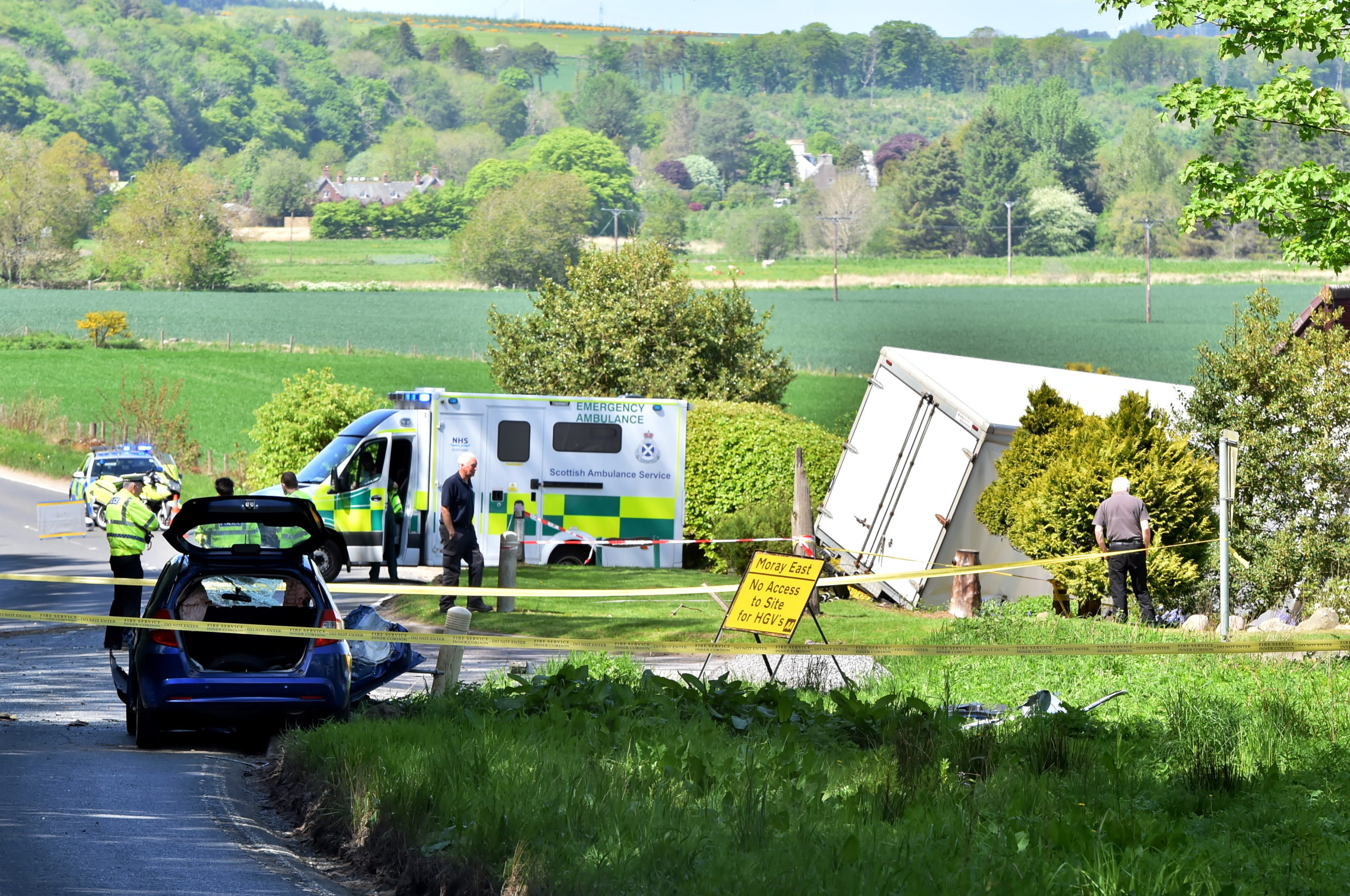 Police at the scene of the crash on the A947 yesterday
