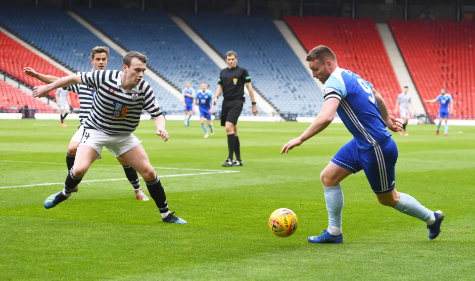 Rory McAllister takes on Queen's Park';s Lewis Magee.
