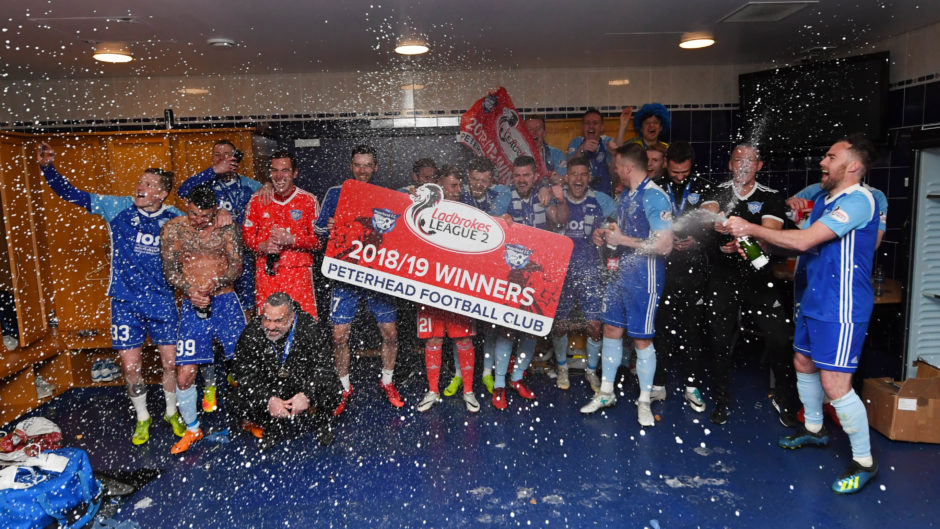 There were chaotic scenes in the Peterhead dressing room after they lifted the trophy.