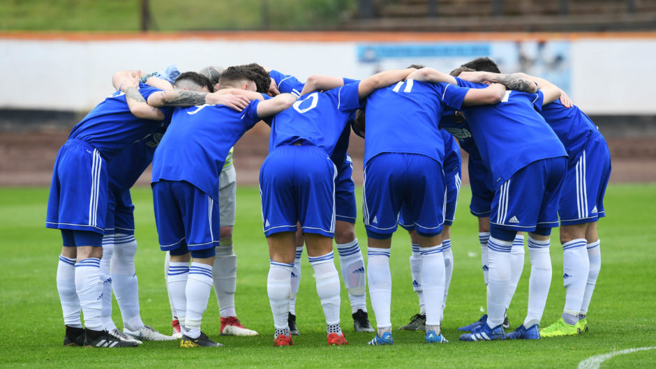 Cove perform their usual pre-match huddle.