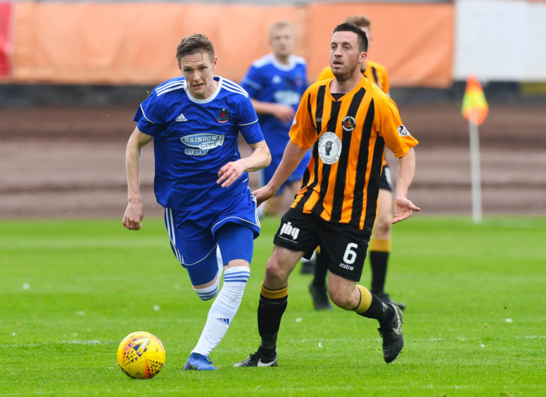 Berwick's Craig Hume in action with Cove's Blair Yule.