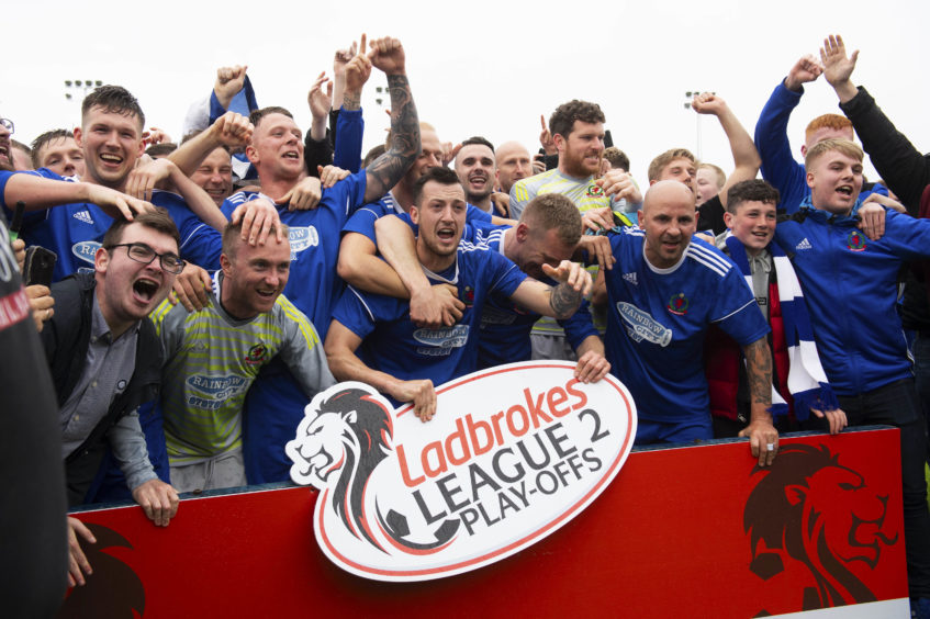 The Cove Rangers squad celebrate winning the Ladbrokes League 2 play-offs.
