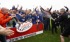 Cove Rangers players celebrate going up.