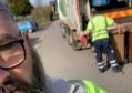 Waste staff social distancing while out and about in the city