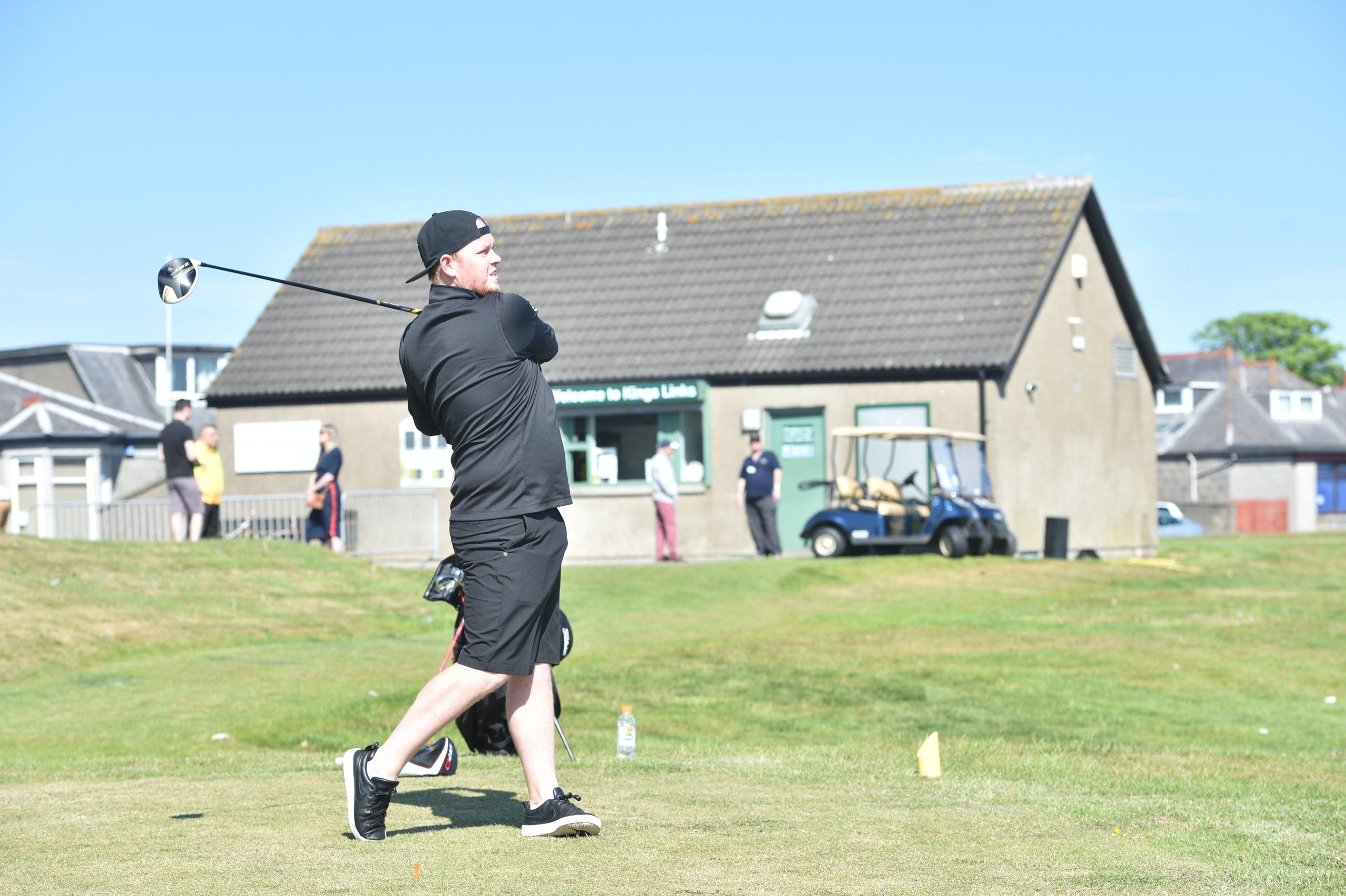 Golfer Stephen Inglis tees off at Kings Links.