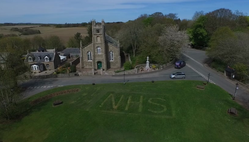 The tribute on the grass in Udny Green