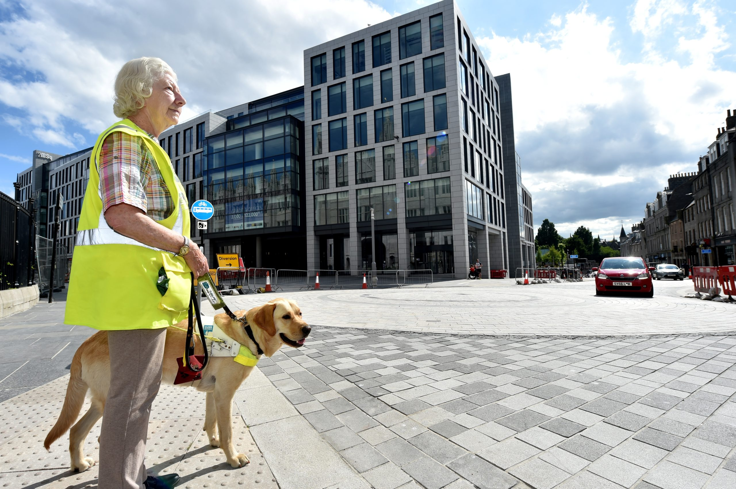 Mary Rasmussen and her guide dog Vince