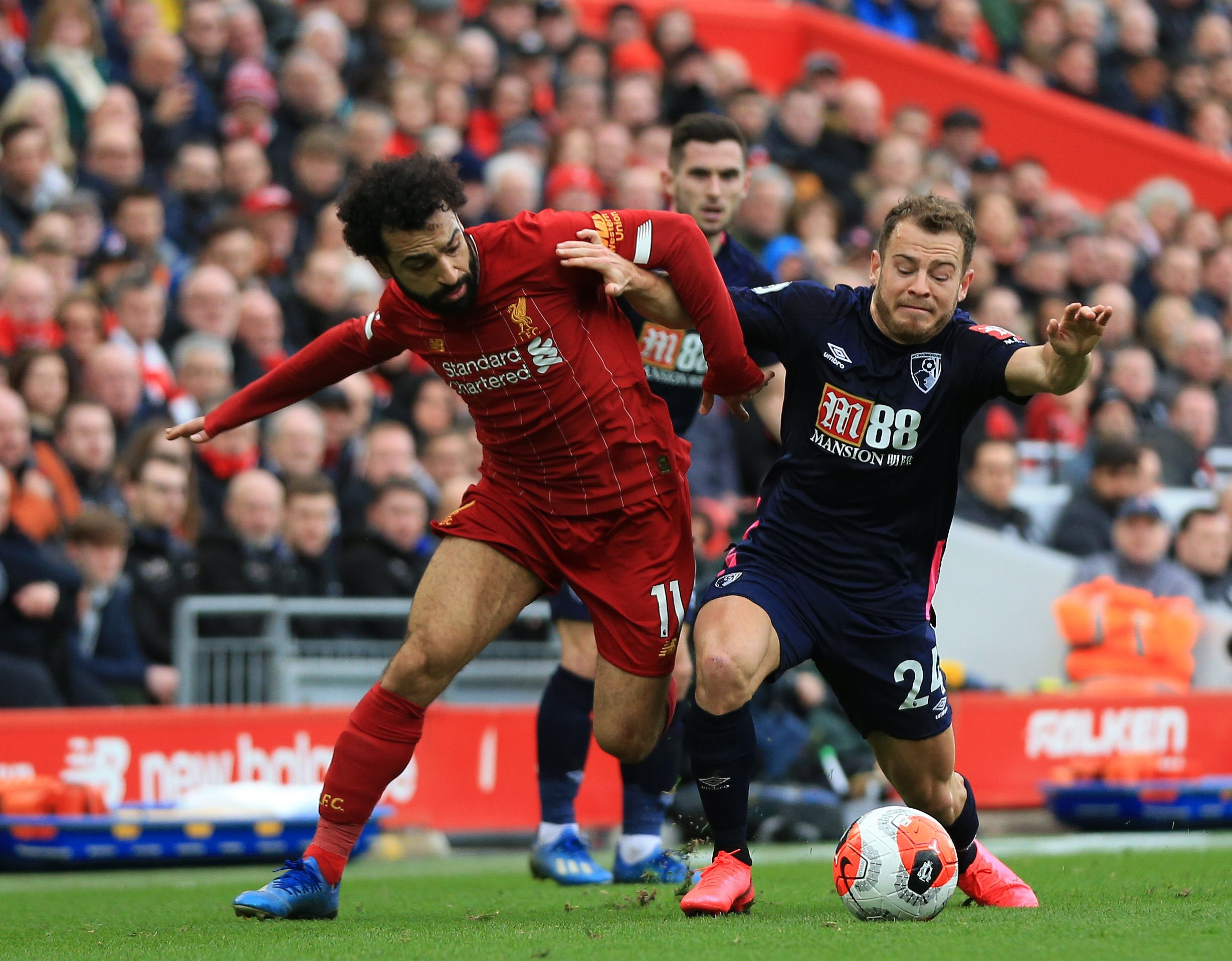 Ryan Fraser, right, tangles with Liverpool's Mo Salah.