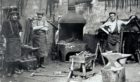 A photograph from the 1920s, featuring   three blacksmiths in Aberdeenshire.