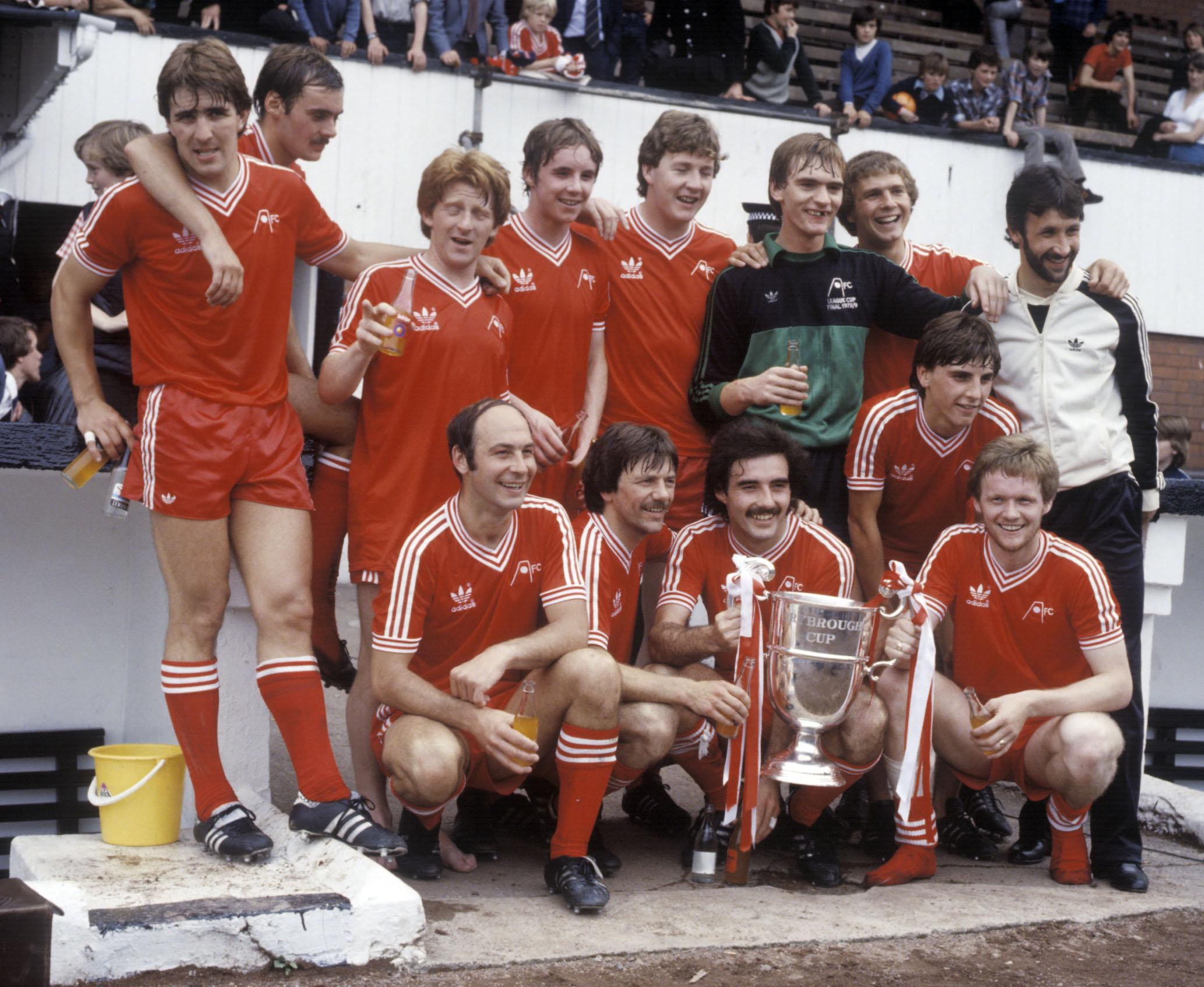 The Aberdeen players celebrate winning the Drybrough Cup in 1980. Back row from left: Mark McGhee, Andy Watson, Gordon Strachan, Steve Cowan, Willie Garner, Jim Leighton, Doug Considine and Ian Scanlon. Front row from left: Drew Jarvie, Stuart Kennedy, Willie Miller, John Hewitt and John McMaster.