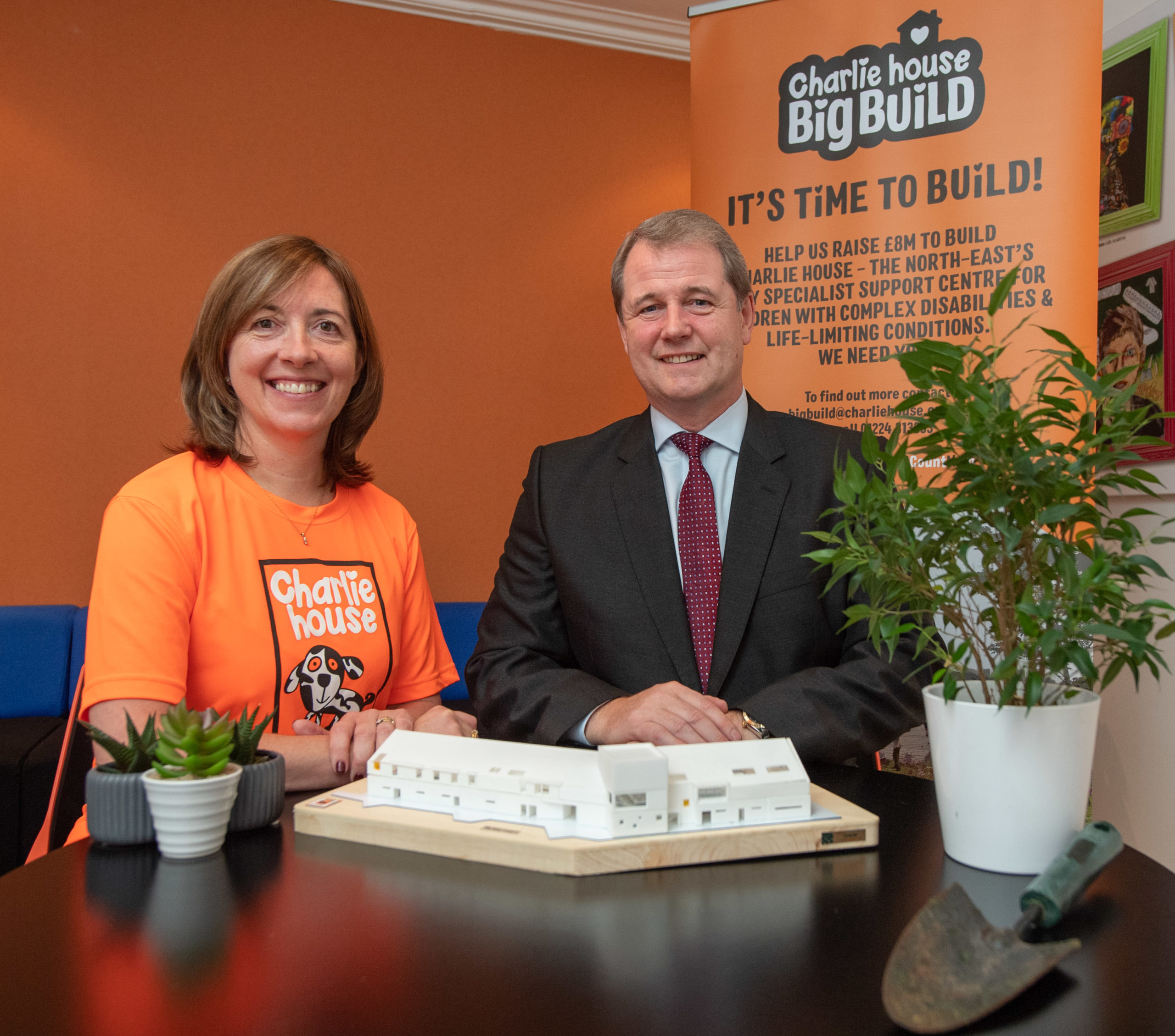 Susan Crighton and Donald Taylor raising funds for Charlie House in the Big Build campaign