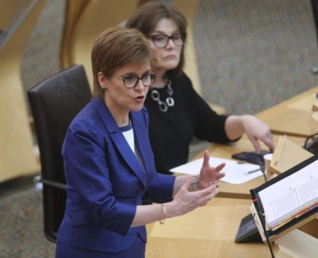 Nicola Sturgeon takes questions at Holyrood.