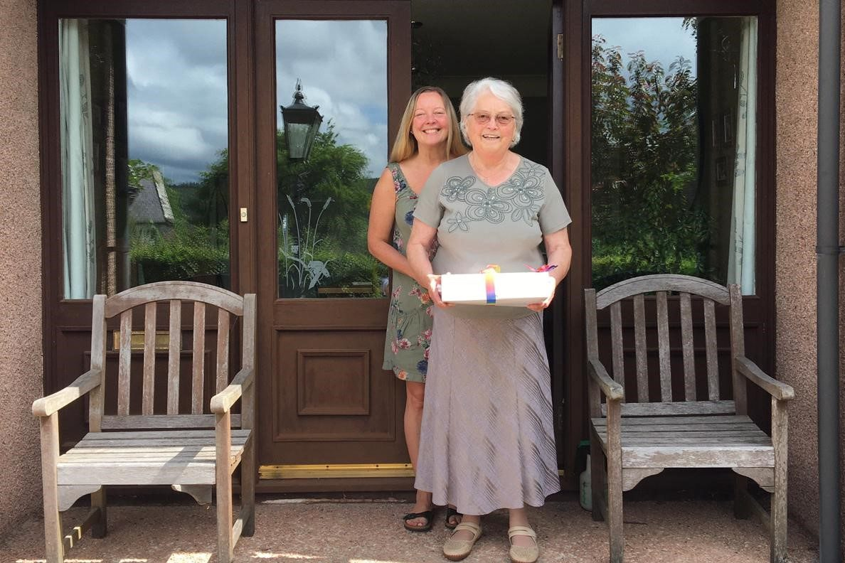Gertie and her daughter Heidi receiving their afternoon tea