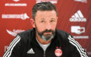 "Aberdeen manager Derek McInnes said he thought the test result was a ""false positive""."