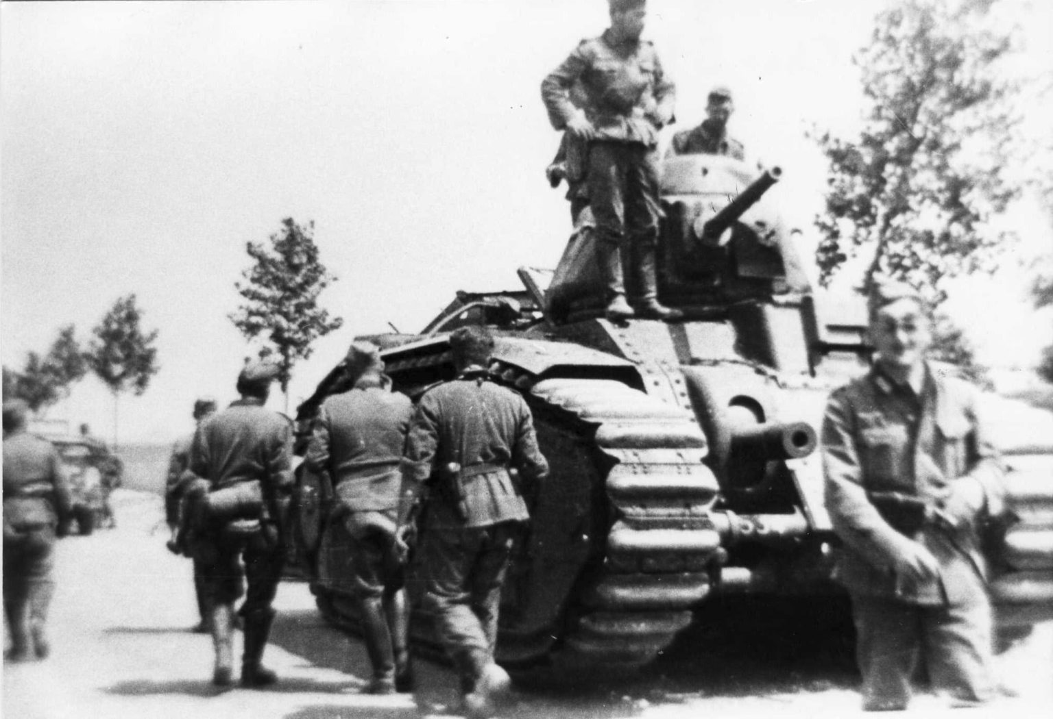 German troops with a Char B tank used by the Nazi forces during the occupation of Jersey in the Second World War.