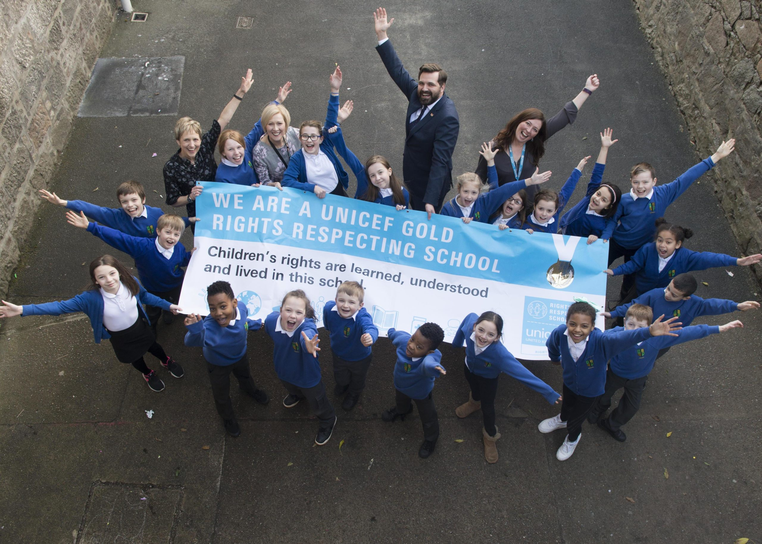 Councillor John Wheeler celebrating with Ferryhill School pupils on the occasion of their Unicef Rights Respecting School Gold Award last year
