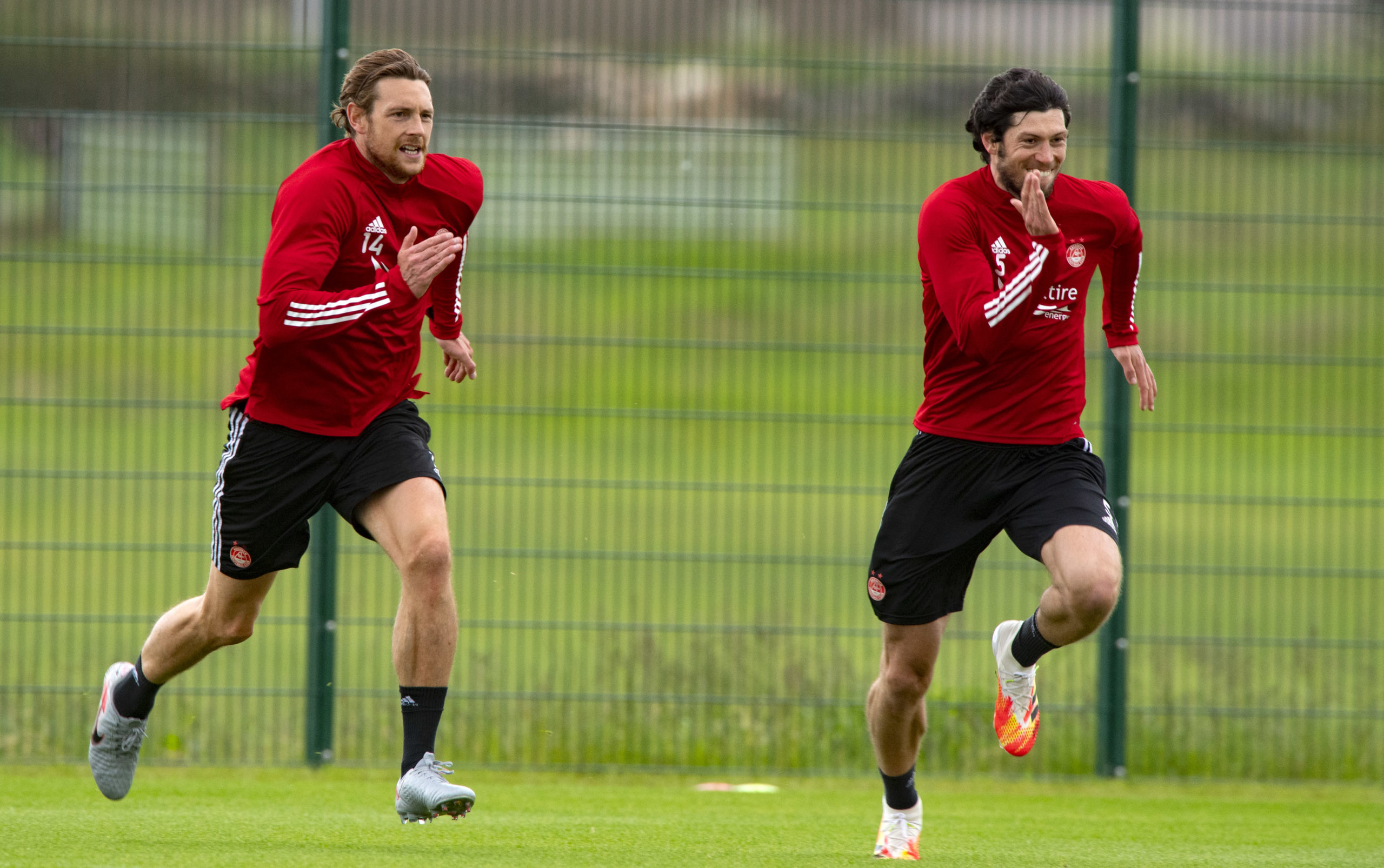 Centre-backs Ash Taylor, left, and Scott McKenna race in training.