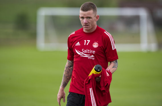 Jonny Hayes training with the Dons.