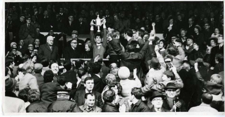 Martin Buchan, Aberdeen FC captain, holds aloft the Scottish Cup having beaten Celtic FC 3-1 at Hampden Park, Glasgow.