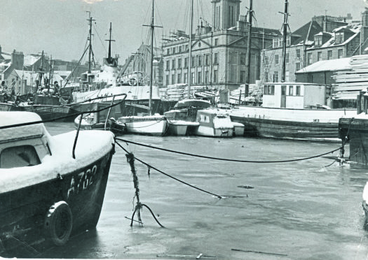 A wintry scene at Regent Quay, beside the harbour board building