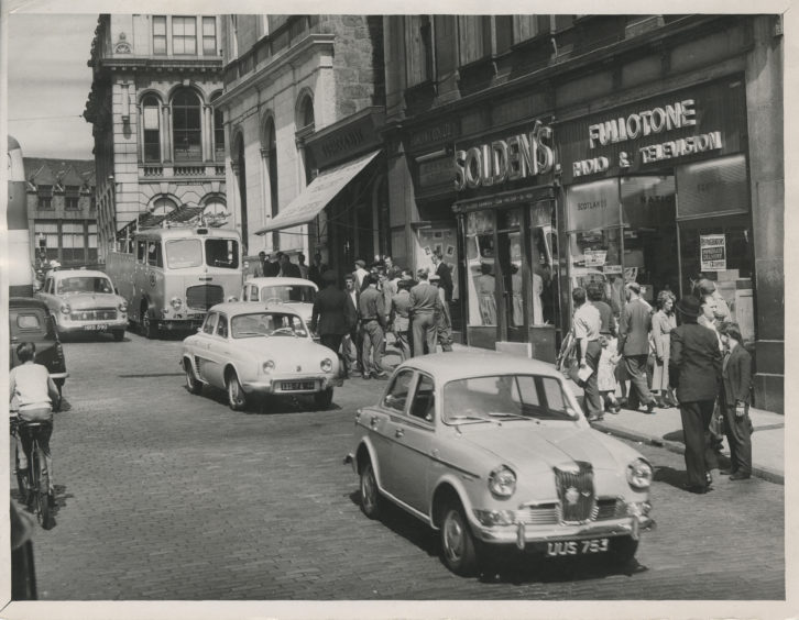 A view of Market Street, Aberdeen.  Solden's store and Fullotone Radio & Television store can be seen. 2 July 1959.