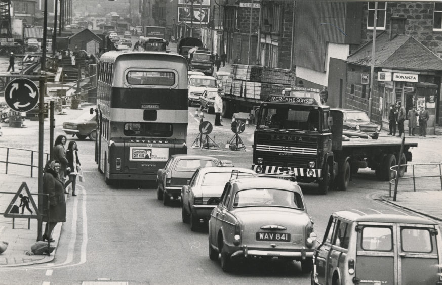 A temporary mini roundabout at the junction of Market Street and Guild Street, Aberdeen.  26 February 1974