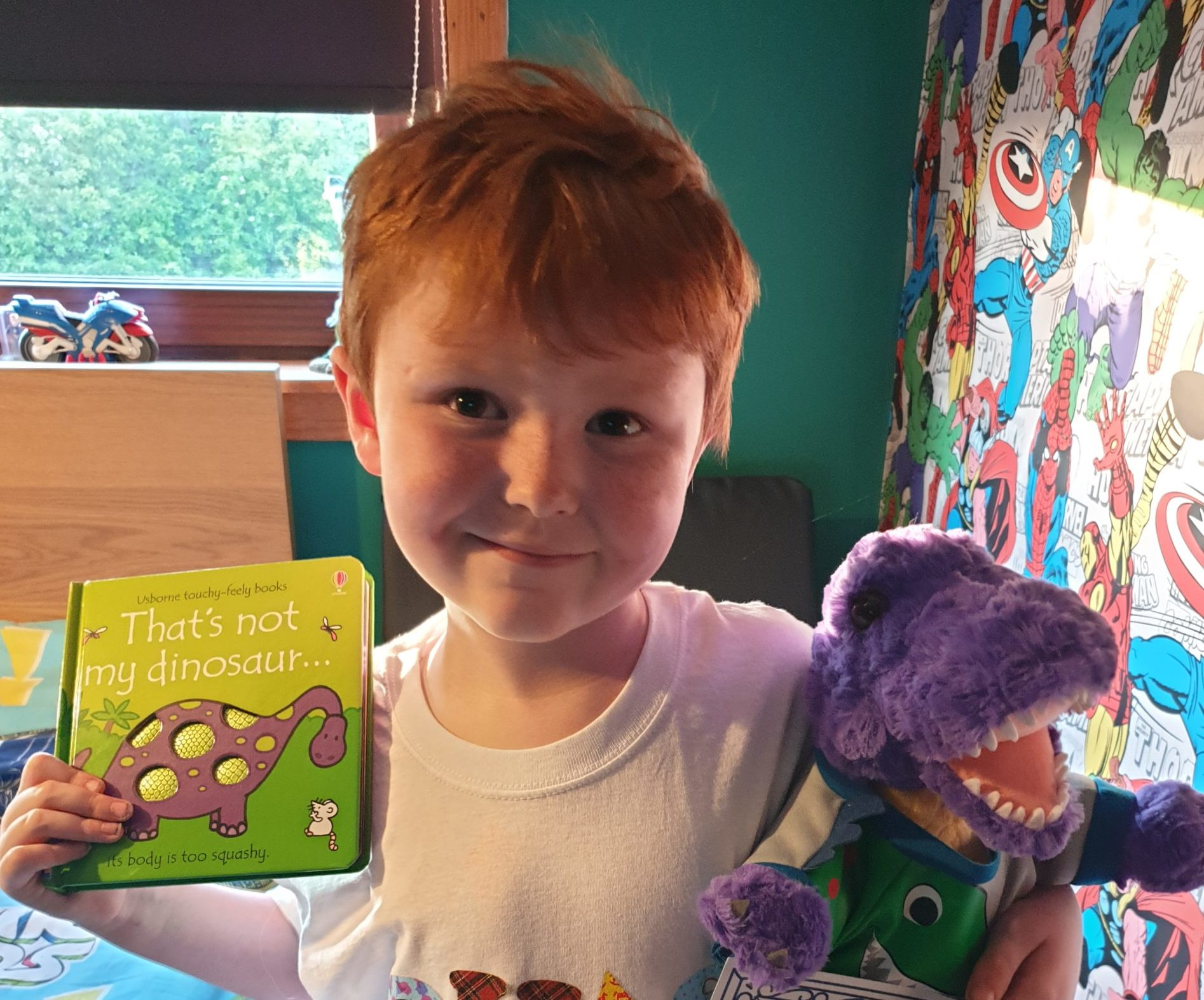 Connor Easdale with Chas the dinosuar teddy