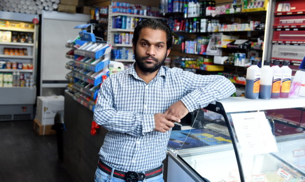 Muja Hid Ali tackled the knife-wielding thug as he tried to flee the shop.