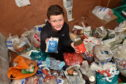 Ross Sharp, 11, with some of the donations he has gathered. Picture by Darrell Benns