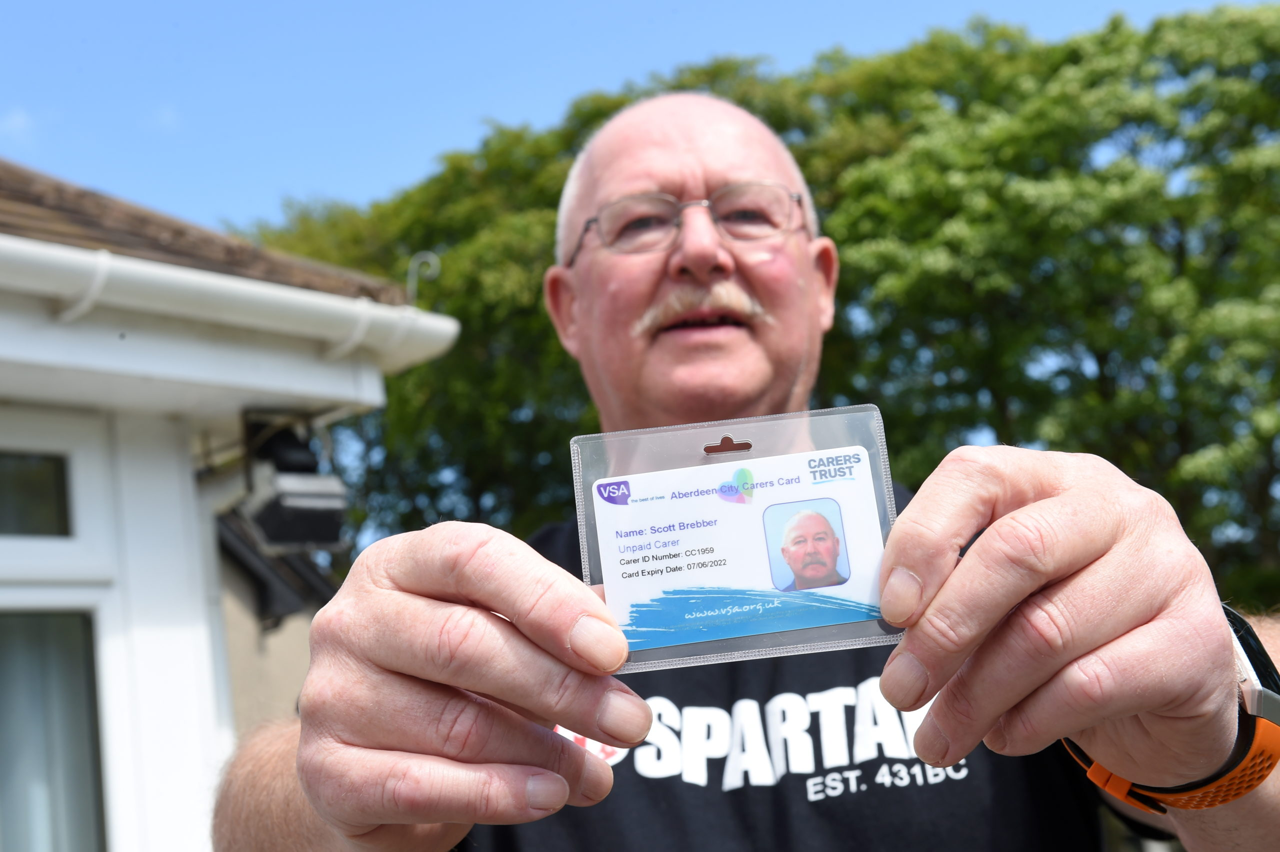 Scott Brebber, who cares for his wife Kathleen who has dementia, is one of the first to receive his VSA Carers ID card. Picture by Paul Glendell