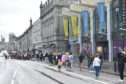 Shoppers queue on Union Street as stores reopened yesterday