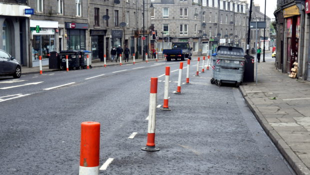 The pavements on the busiest shopping segment of Victoria Road, in Torry, will be temporarily widened to help keep the public safe