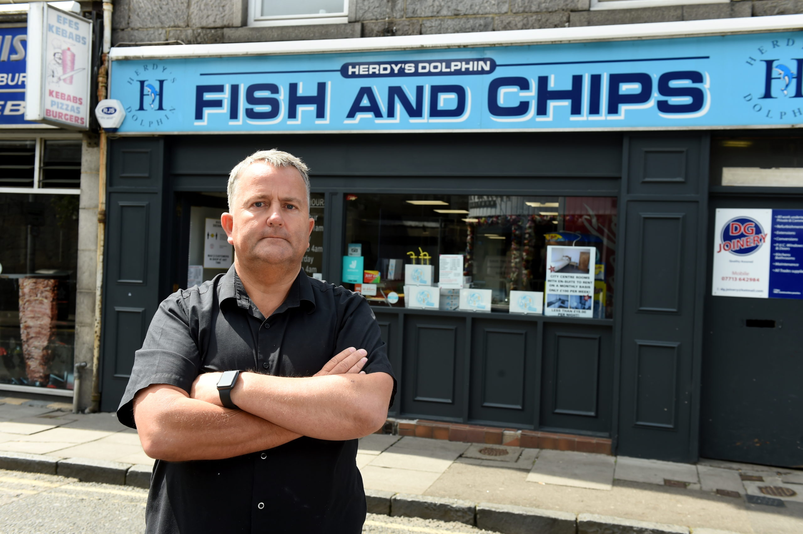 Graeme Herd outside Dolphin Fish and Chips on Chapel Street