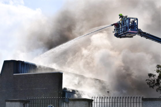 Firefighters tackle the blaze at Byron Square. Picture by Kami Thomson