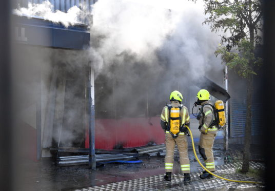 Emergency services attend a fire at Byron Fast Foods. Picture by Kami Thomson