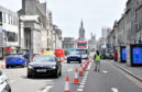 Barriers and water-filled containers have been put in place this week to stop vehicles driving down Union Street's closed-off section