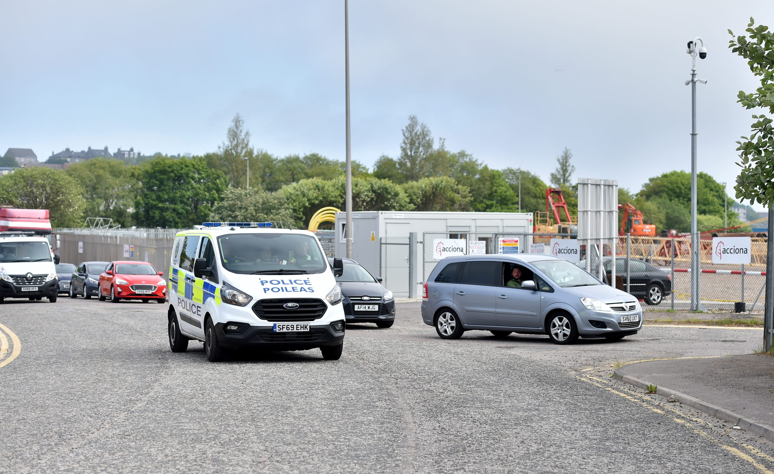 Police oversee traffic at the Tullos recycling centre